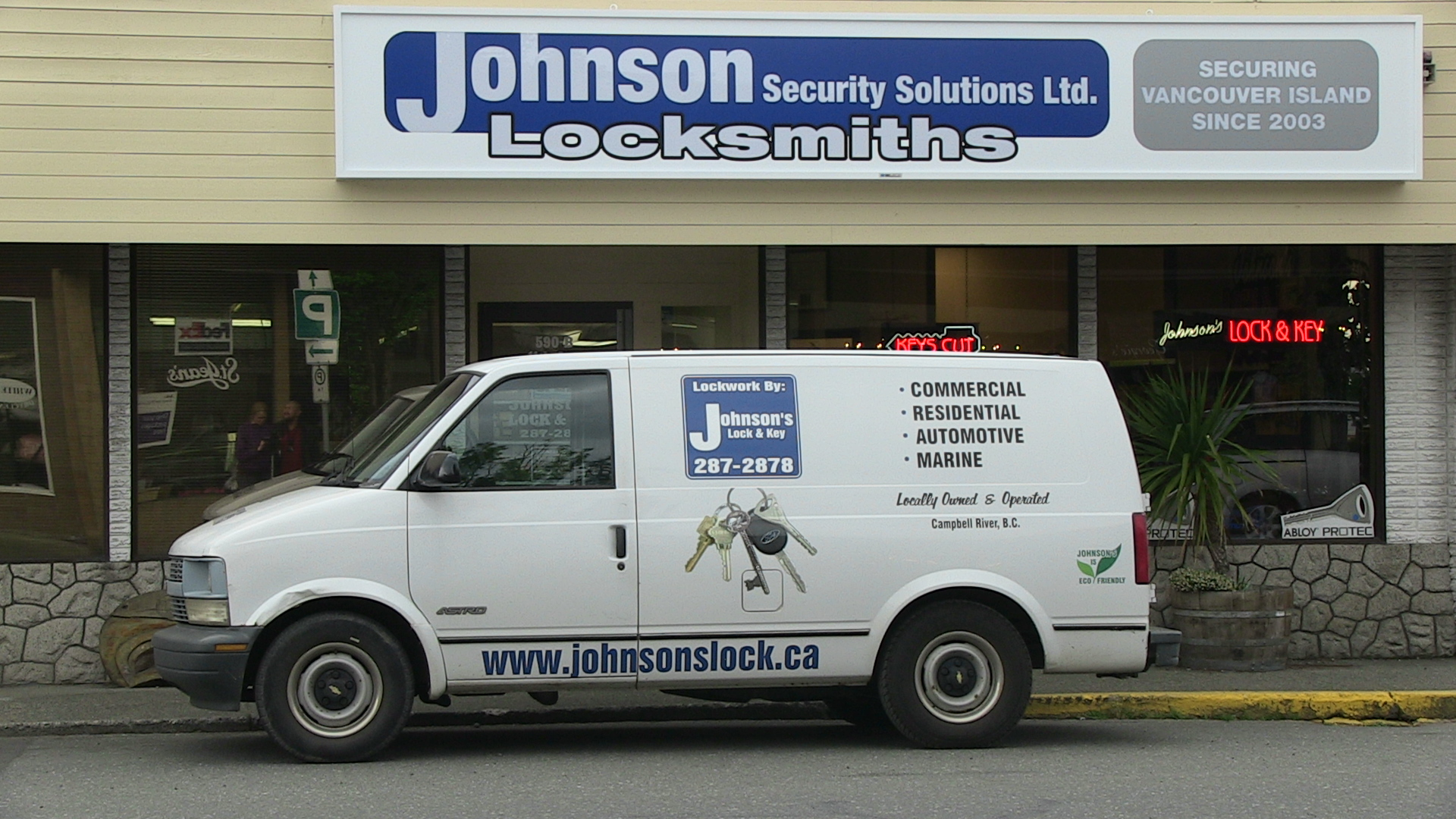 New store front picture with shop van